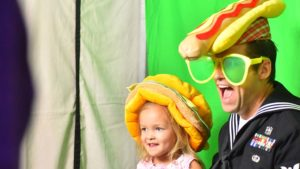 A father and daughter create a fun photo at the YMCA Father & Daughter Dance.