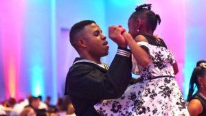 Damian Bertrand and his daughter, Dania, 8, enjoy dancing.