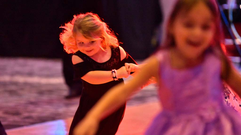 Young girls also danced with each other on the dance floor.