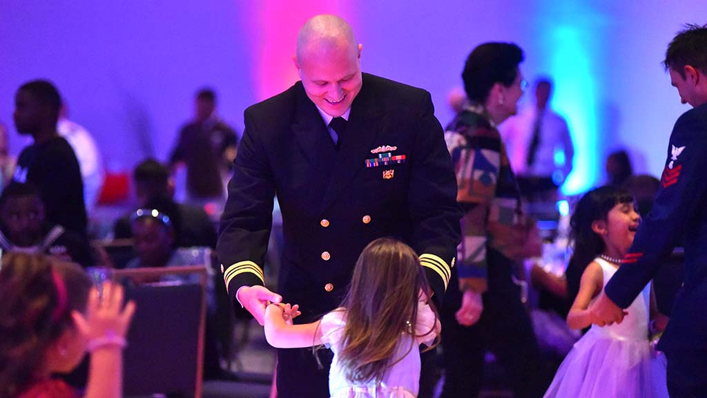 Lt. Cmdr. Brandon Vier dances with his daughter, Kaitlin, 5, at the Father & Daughter Dance.