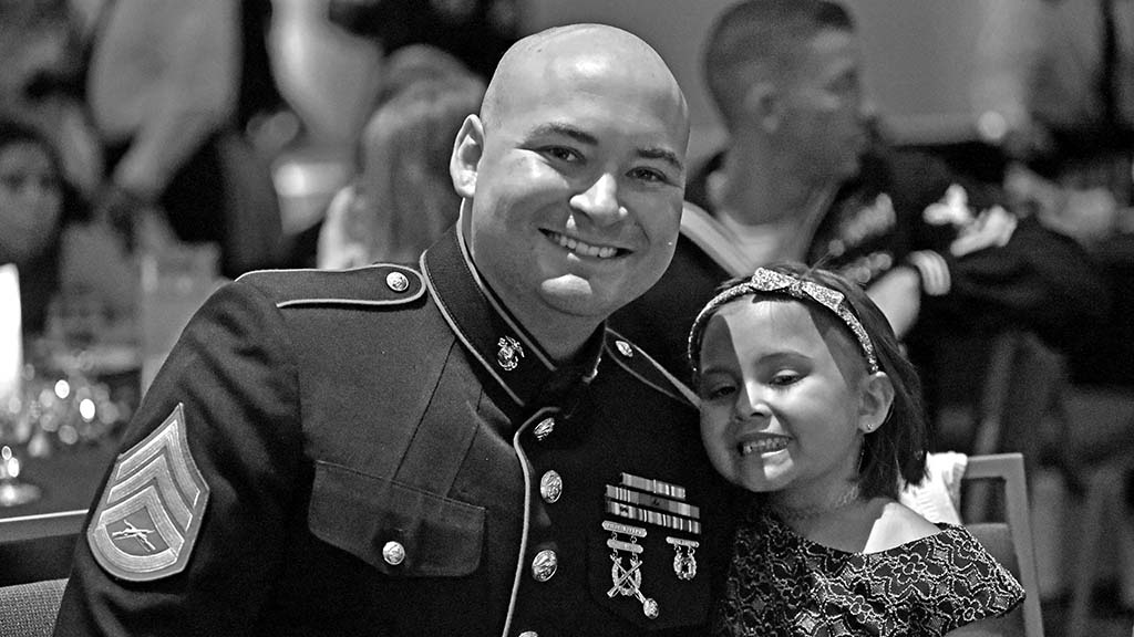 Marine Sgt. Raymond Bankes enjoys time with his daughter, Aunaleigh.
