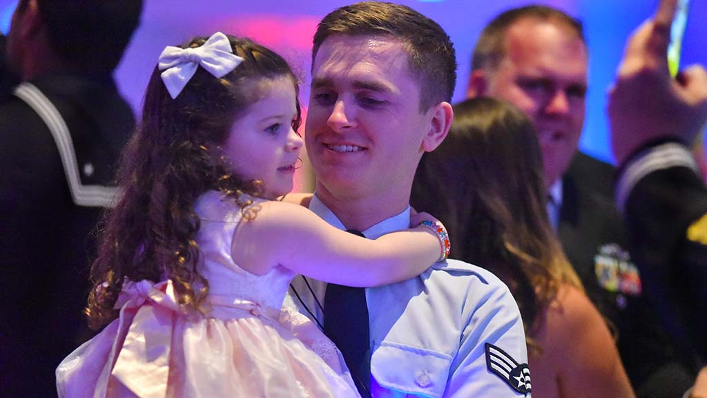 A senior airman shares a special moment with his daughter on the dance floor.