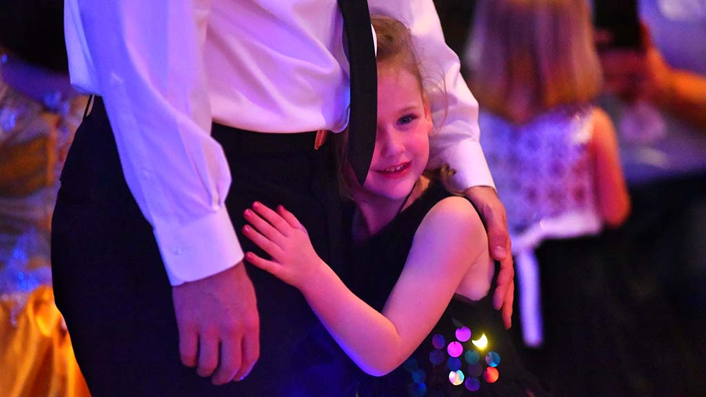 Madison Allen, 5, hugs her father Chief Petty Officer Brian Allen at the Father & Daughter Dance.