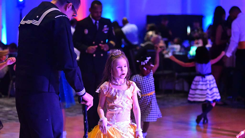A girl dressed as a princess dances at the Armed Services Father & Daughter Dance.