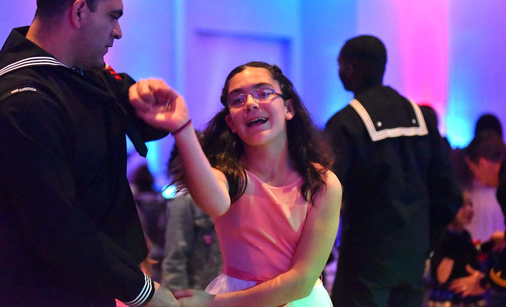 A daughter enjoys dancing with her father at the annual Father & Daughter dance.