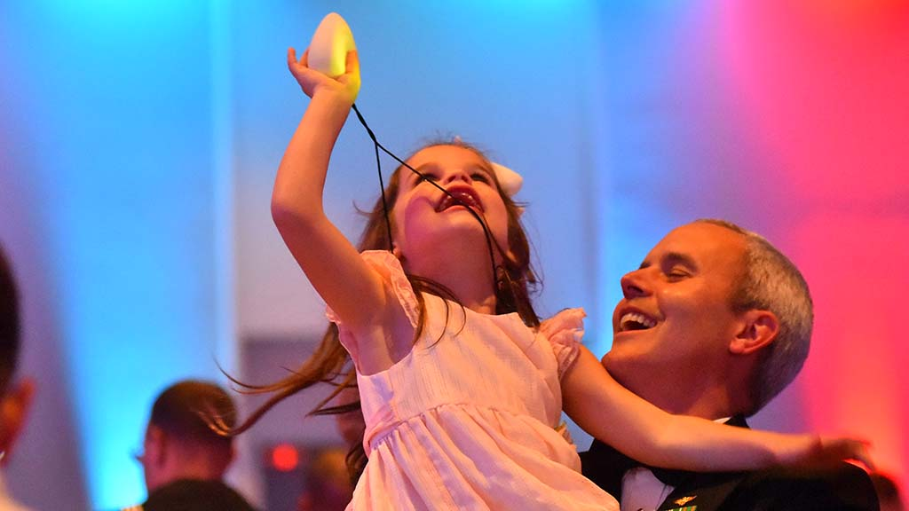 Cdr. Matthew Kiser and Kathryn Ross, 5, enjoy YMCA Father-Daughter Dance.