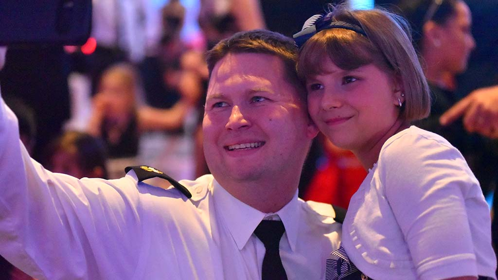 Jeremy Butler takes a selfie with his daughter, Persephone, 10 at the dance.