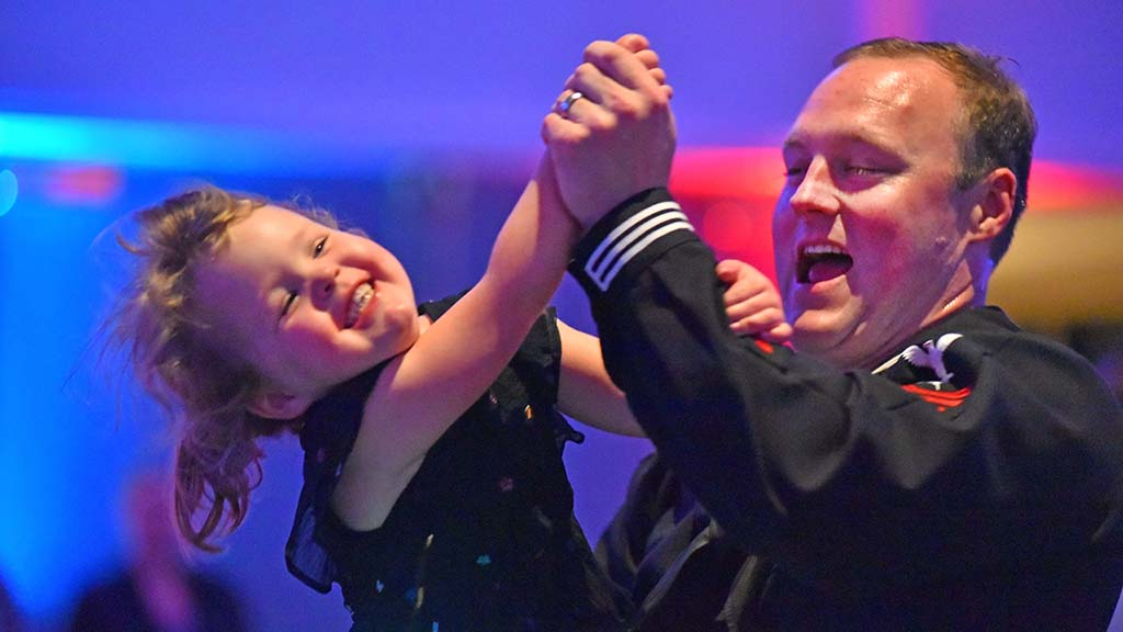 Navy Petty Officer Joe Kleefisch and his daughter Riley, 3, enjoy the YMCA Armed Services Father Daughter Dance in Mission Valley.