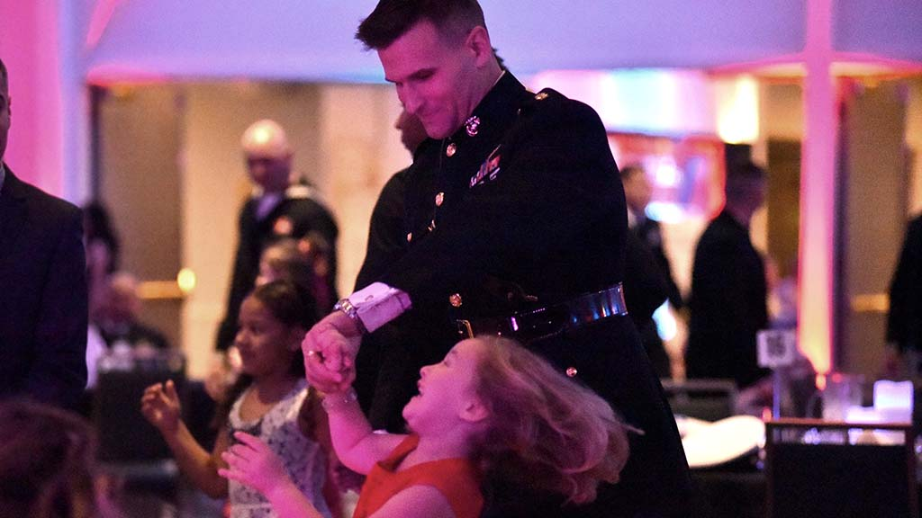 Maj. Frank Machniak twirls his daughter, Lillian, 6, on the dance floor.