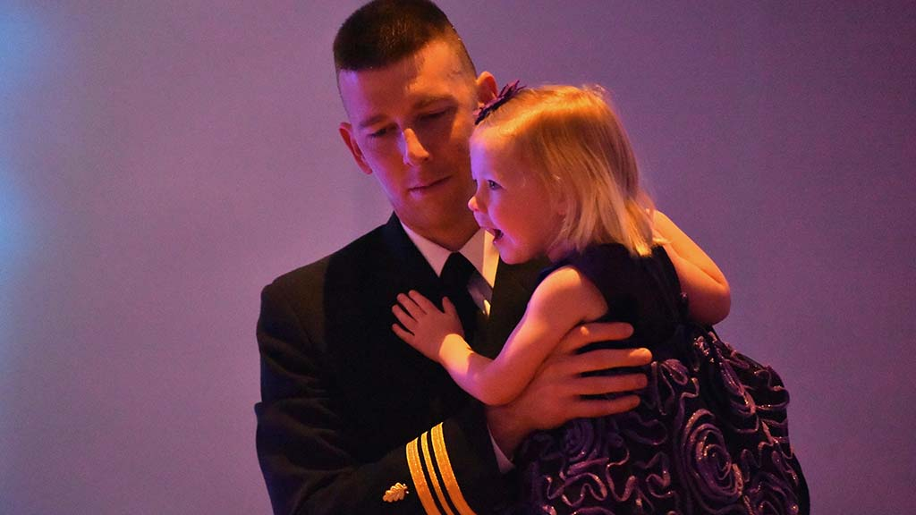 A father and daughter share a special moment on the dance floor.