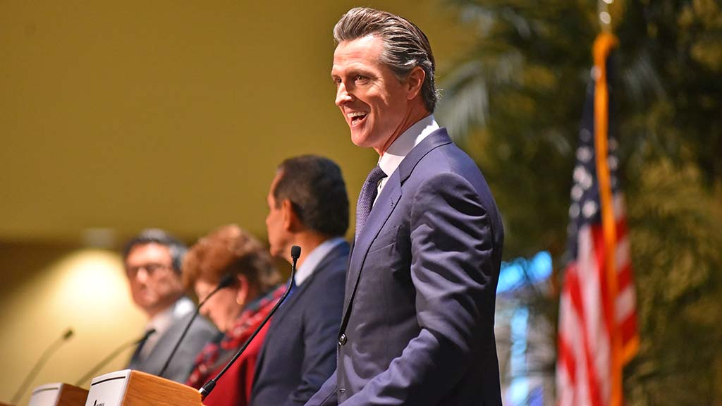 Democratic gubernatorial candidate Gavin Newsom reacts to the audience before the debate.