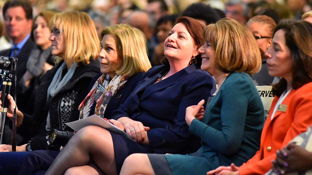 State Sen.Toni Atkins (third from the right) and U.S. Congresswoman Susan Davis react before the debate.