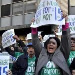 Home care workers rally in 2015 in downtown San Diego to call for a raise in minimum wage to $15.