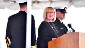 Susie Buffett, daughter of Warren Buffett, officially declares the USS Omaha as an active ship.