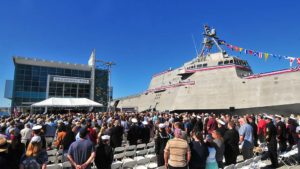 Hundreds of Navy personnel and family members attend the commissioning of the USS Omaha.