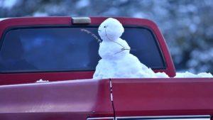 Snowman in truckbed