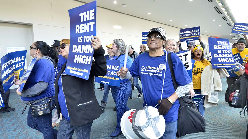 Protestors marched against a state law that limits rent control.
