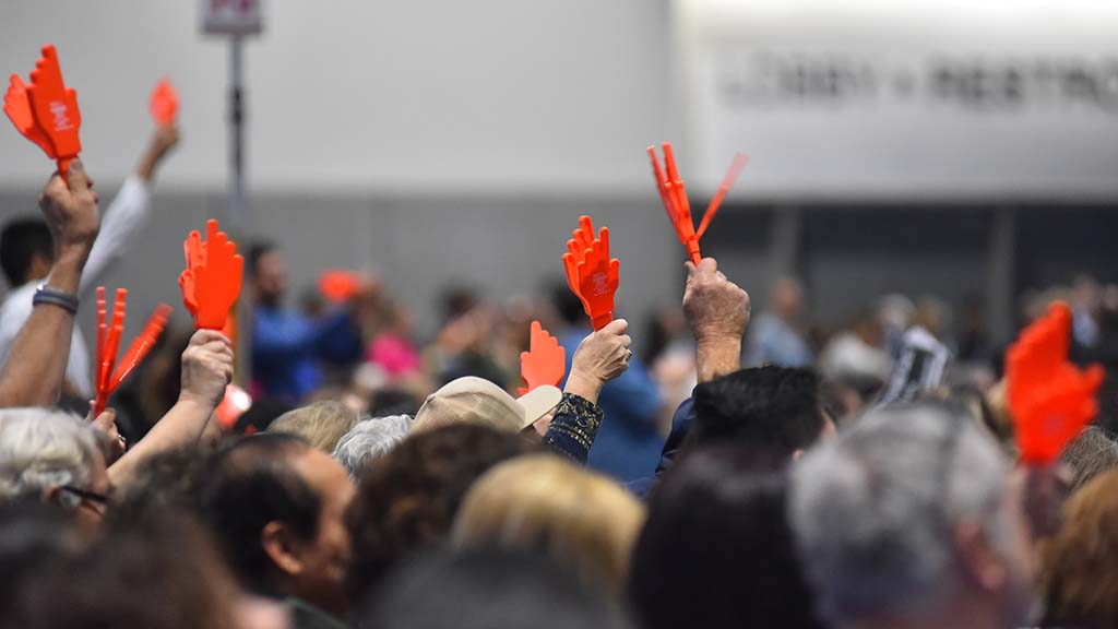 Delegates uses plastic clapping hands to signal their support of candidates.