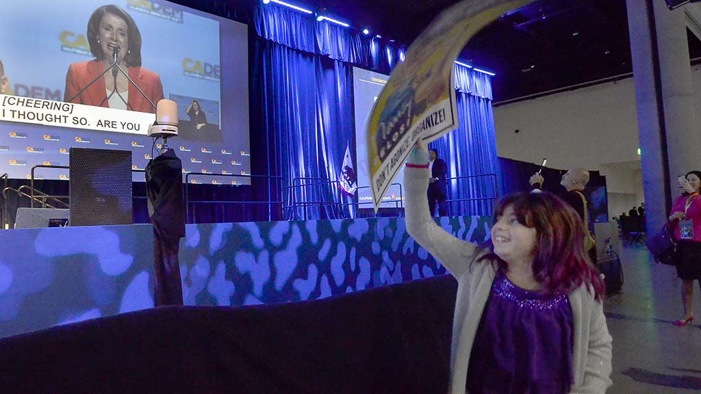 House Minority Leader Nancy Pelosi's eight-year-old granddaughter, Bella, cheers for her during a convention speech.