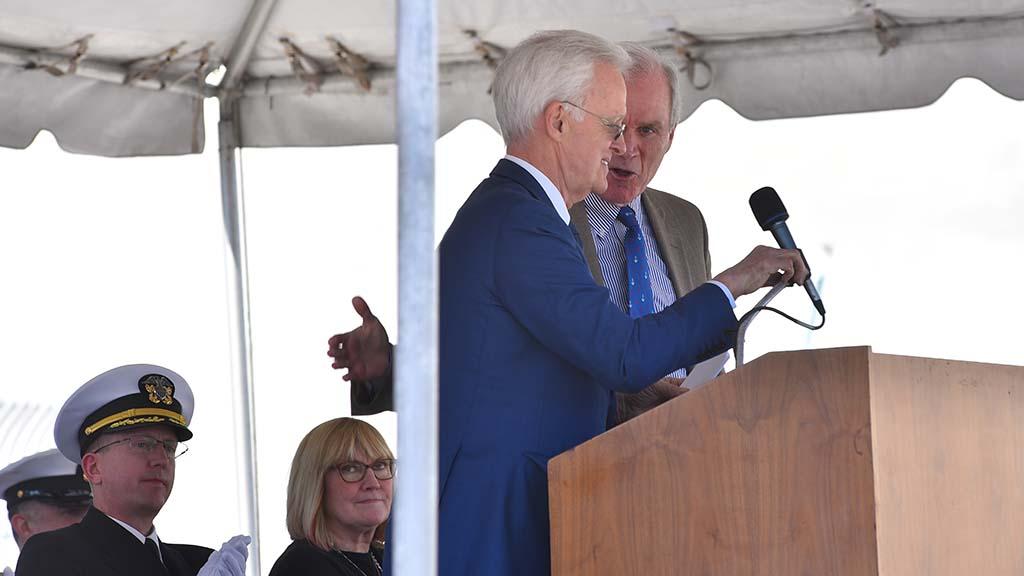Navy Sec. Richard Spencer (right) greets former Nebraska Sen. Bob Kerry.
