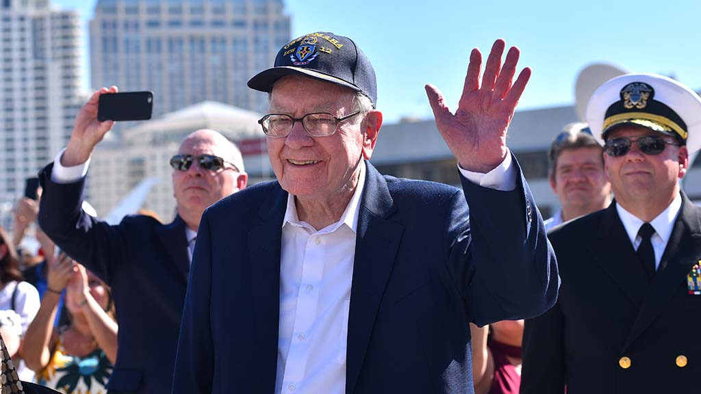Wall Street tycoon Warren Buffett watches as his daughter, Susan, the ship's sponsor, participates in the event.