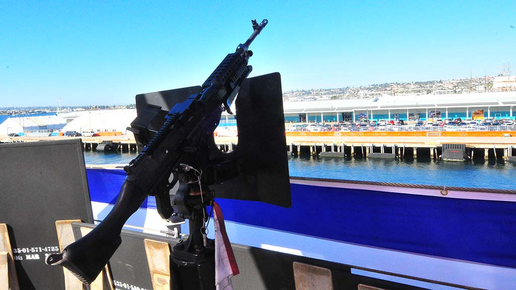 A weapon is positioned on the USS Omaha.