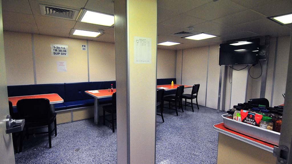 A dining area on the USS Omaha is ready for the crew.
