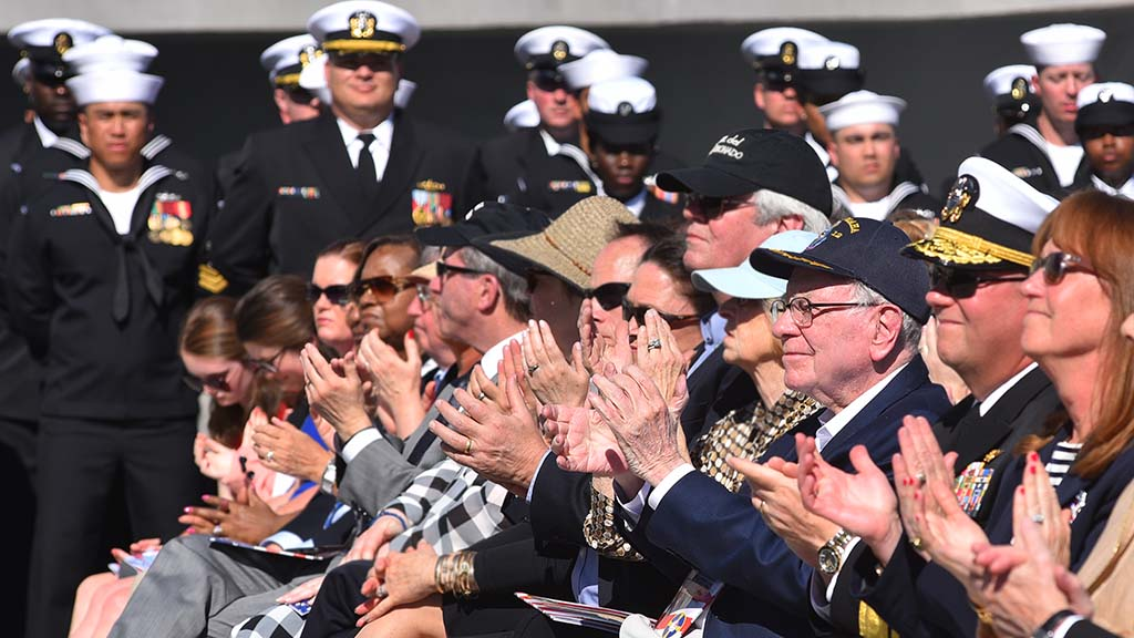Guests including Warren Buffett (third from the right) applaud during the ceremony.
