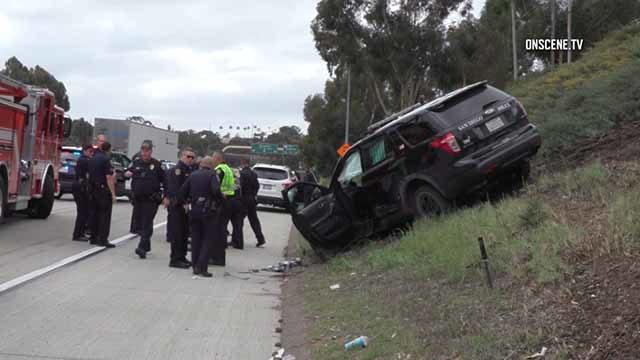 Rescue crews including San Diego police responded to officer's crash of southbound I-15 near I-805.