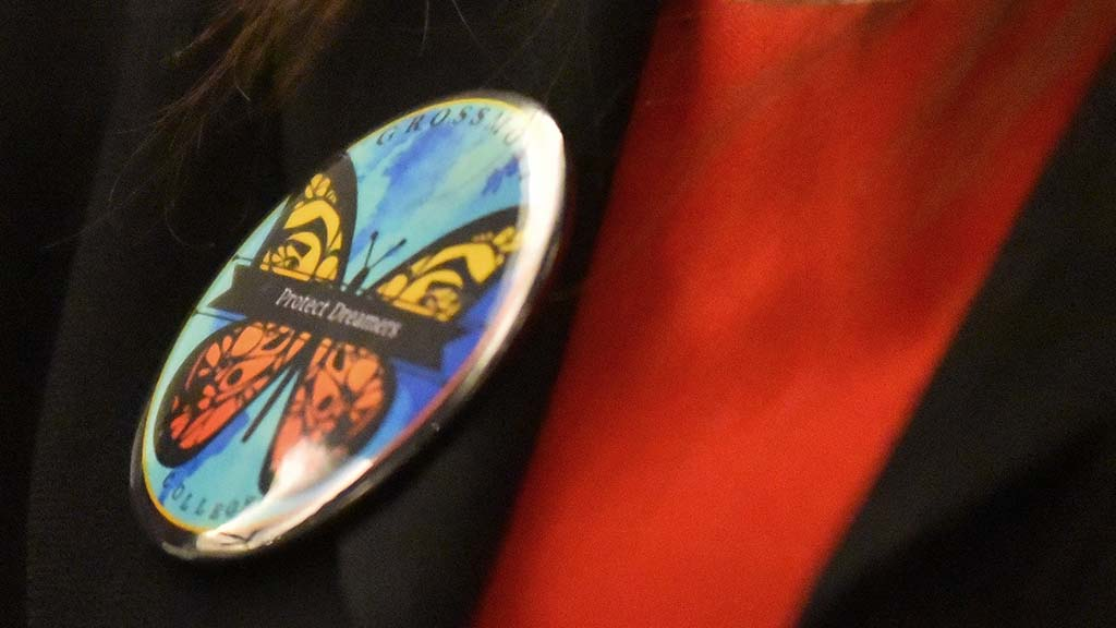 "Dulce Garcia, a plaintoff in DACA suit, wears a ""Protect Dreamers"" button at forum"