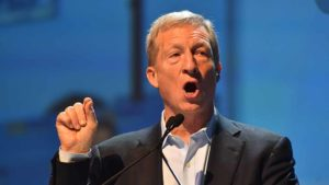 "Tom Steyer at San Diego Convention Center says: ""Our federal government has put corporate interests ahead of the public interest, creating national crisis every time some corporation uses the system to cash in. Our working families struggle to pay the bills because executive and stockholders get more when their employees get less."""
