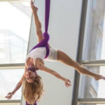 Dancer on trapeze at airport