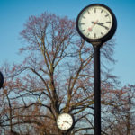 Clocks on poles in a field