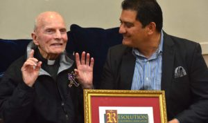 The Rev. Richard Brown reacts as State Sen. Ben Hueso presents him with a state legislature resolution with his name.