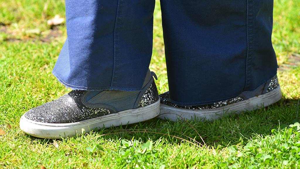 Evangelina Rodgers' sparkly shoes complement her Cub Scout uniform as she does balance exercises.