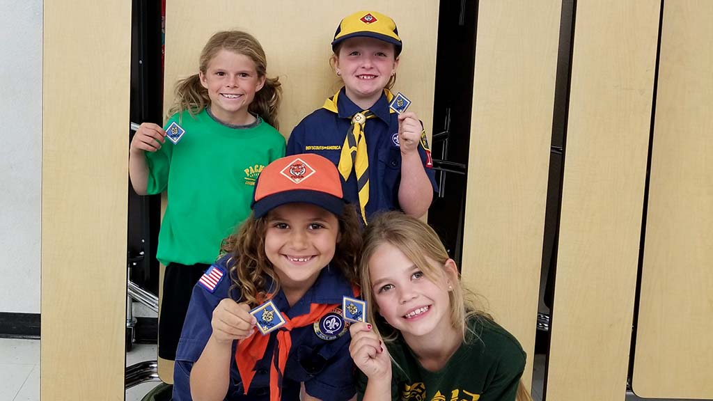 Victoria Randall, Laura Hutto, Evangelina Rodgers, and Isabelle Marcus receive their first patches.