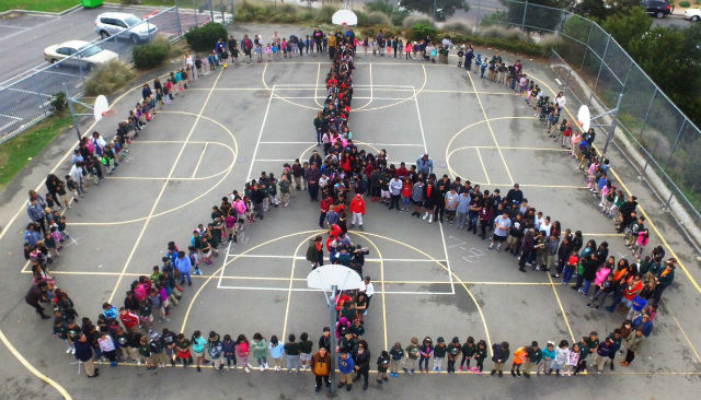Students form a peace sign