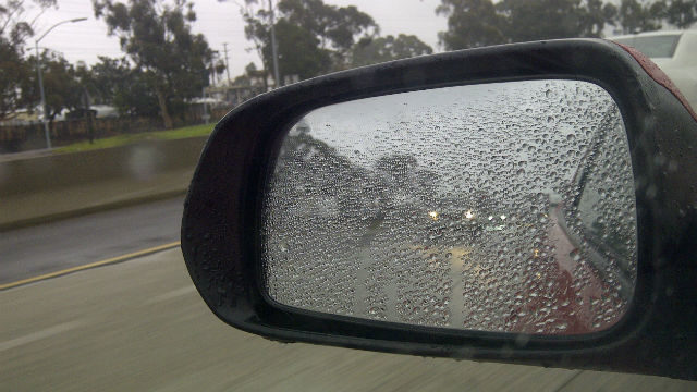 Rain on car's side mirror