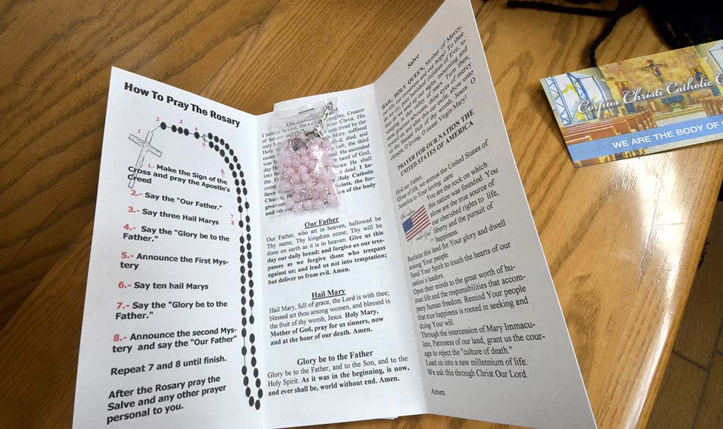 Blanco distributes his rosaries in prayer pamphlets that he customizes and prints.