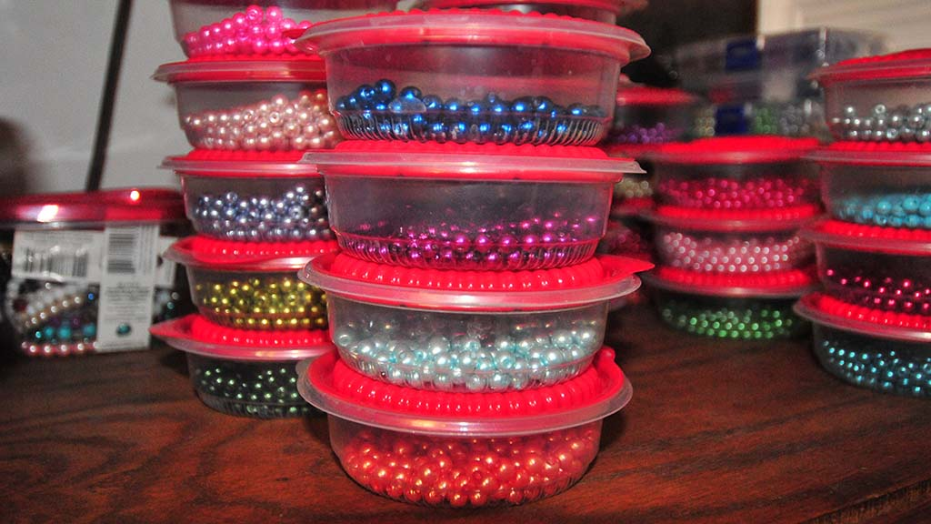 Beads for rosaries are stored in fast-food containers.