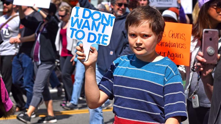 A young boy protest against gun violence in downtown San Diego.