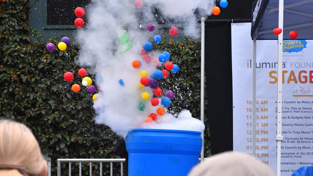 Liquid nitrogen causes a container of colorful balls to fly skyward