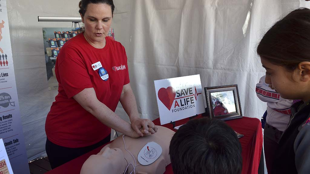 Save A Life Foundation members demonstrate to way to restart a heart.