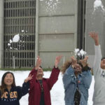 Students throwing snowballs