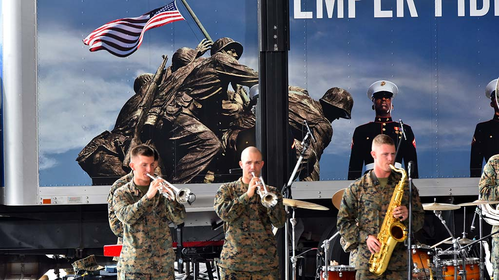 Iwo Jima iconography backed up Marine Corps band, entertaining the troops before presidential visit.
