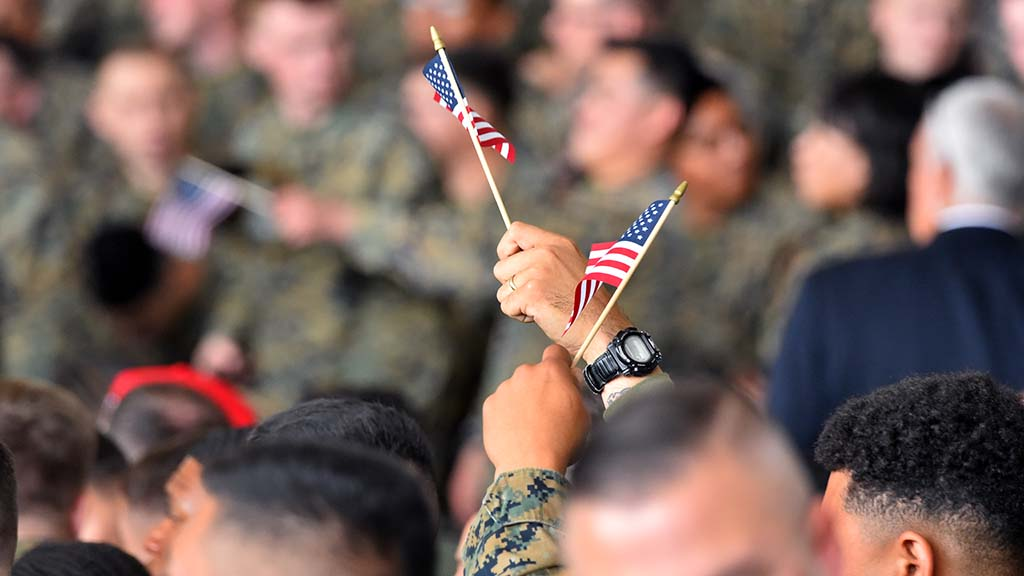 Many members of the audience waved small flags at President Trump's visit to MCAS Miramar.