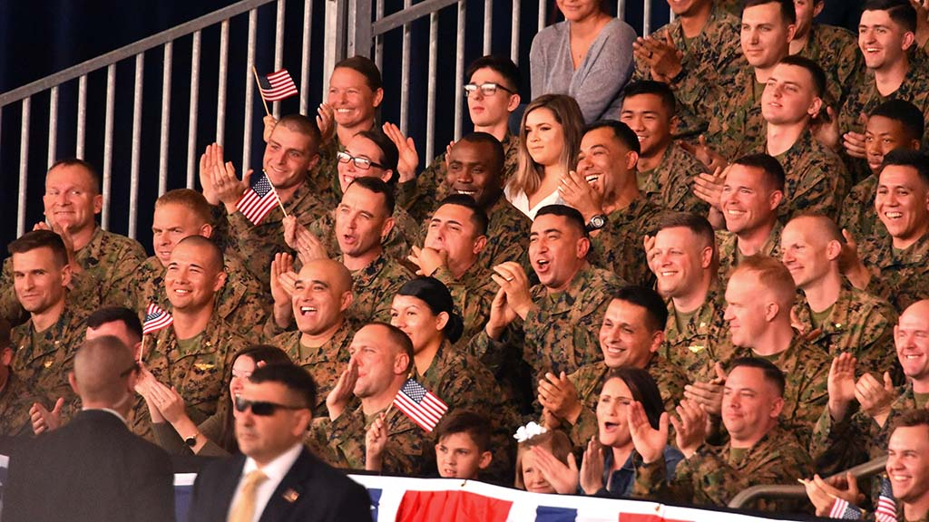 Marines cheer and applaud President Trump's vow of more military aircraft.