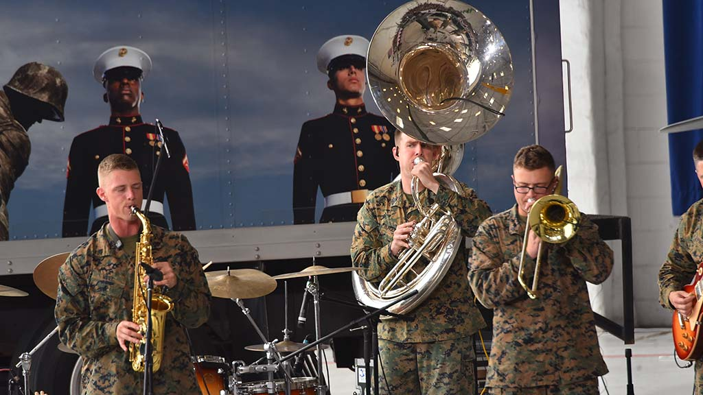 "Marine Corps band played jazz and standards like ""Stars and Stripes Forever"" before the commander in chief arrived at hanger."