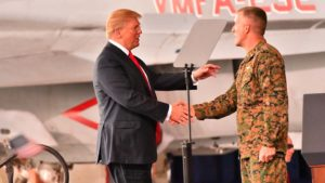 President Trump is greeted a little before 2 p.m. by Marine Col. Jason Woodworth, MCAS Miramar commander, after arrival from Otay Mesa and border wall prototype visit.