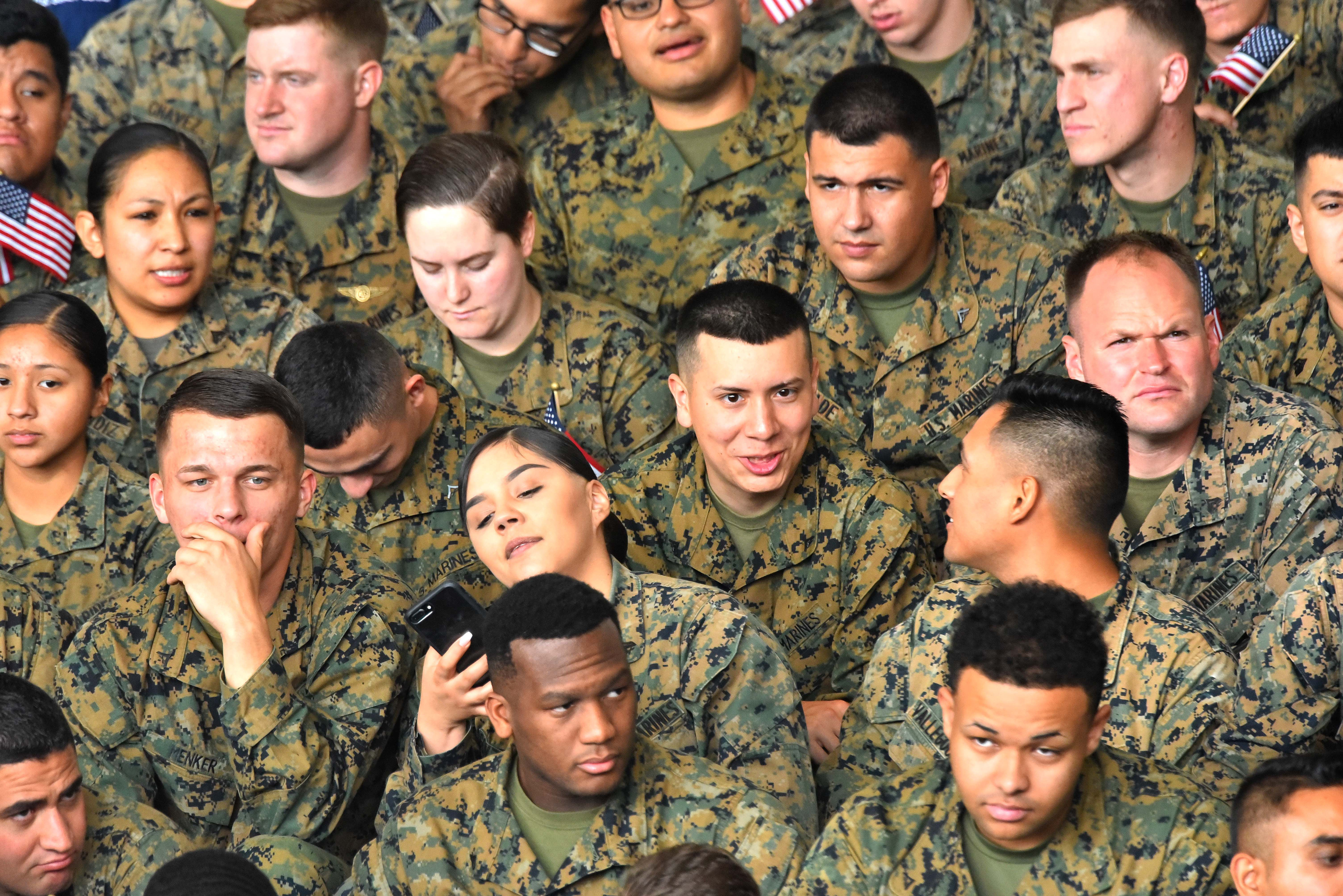 Marines from MCAS Miramar chat and check their phones in the hours before the president spoke.